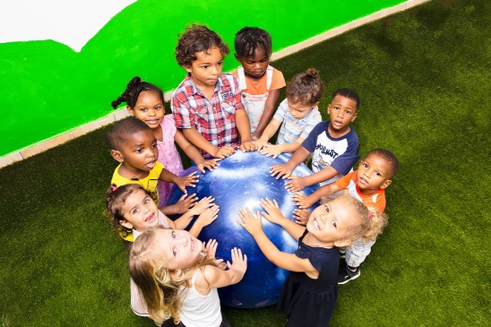 children holding their hands on blue ball